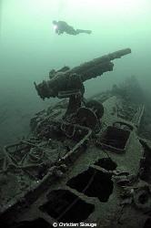 Cannon on the wreck of NK-02 Dragoner/aka KNM Kjell outsi... by Christian Skauge