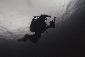 Dark descent. Descending to 40m wreck in the dark waters ... by James Garland