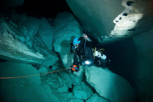 My Dive Buddy reeling back the line in Weebubbie Cave