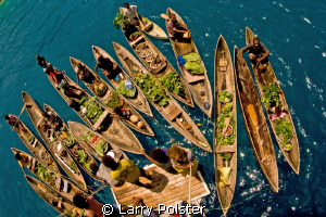 Aboard the Bilikiki , the locals bought the grocery store... by Larry Polster