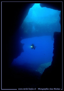 My wife Caroline entering the cave at the bottom of the B... by Michel Lonfat