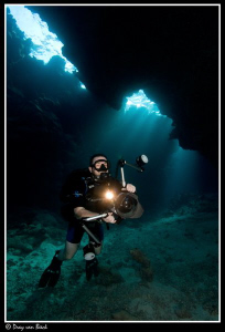 Jim Garland in cave. by Dray Van Beeck