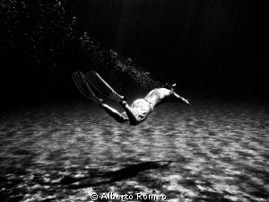 My son   swimming underwater in apnea. Mediterranean sea-... by Alberto Romeo