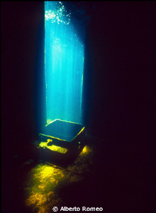 """A blade of sunlight on the hatchway in the wreck of """" Min... by Alberto Romeo"""