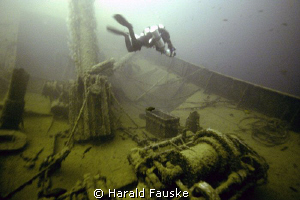 Diver over winch on the wreck of ss Radbod, picture is ta... by Harald Fauske