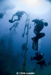 Divers ascending after exploring the stavronikita (shipwr... by Chris Lussier