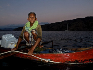 Sustainable fishing. Fisherman in Komodo coming to our L... by Christian Nielsen