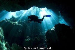 Cave diver doing deco stop in cenote chac mool by Javier Sandoval
