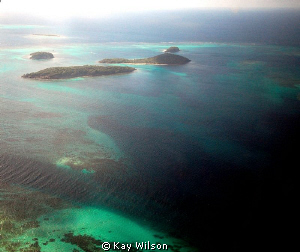 Tobago Cays,  shot from the window of the small plane tha... by Kay Wilson