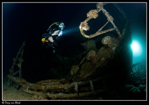 James Dawson on nightdive on the Giannis D_ long exposure. by Dray Van Beeck