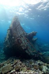 The broken bow of the Kormoran wreck and its coral garden. by Erich Reboucas
