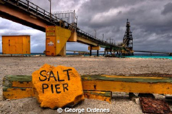 Salt pier on the last day in Bonaire by George Ordenes