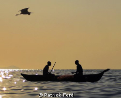 2 fishermen were putting out a net on Lake Malawi near th... by Patrick Ford