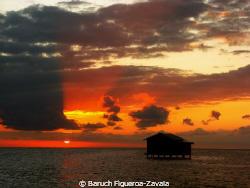 Sunset at Banco Chinchorro Atoll, Quintana Roo, Mexico by Baruch Figueroa-Zavala