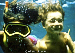 My son Dario at the age of about 2 y.o.  free skindiving ... by Alberto Romeo