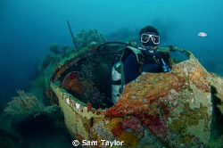 Japanese WWII wreck & our dive guide, Madang Province PNG... by Sam Taylor
