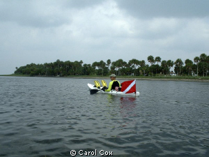 Sea kayaking Saint Joe Bay, Florida by Carol Cox