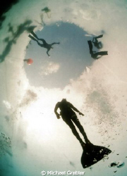 A free diver makes his way back up to the ice entry hole ... by Michael Grebler