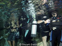 Divers in chandelier cave. by Stuart Ganz