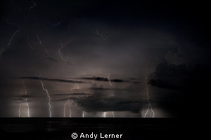 Multiple exposure of a storm over the waters near Amed Bali. by Andy Lerner