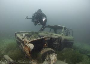 Mark with car wreck. D200, 10.5mm. by Derek Haslam