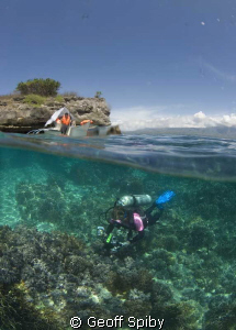 locals enjoying a day out at Pescador island while touris... by Geoff Spiby