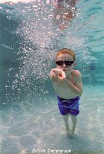 This was shot in my backyard pool with cheap expired film... by Rick Cavanaugh
