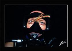 Kaye looking at a ornate ghostpipe fish in Sipadan (Borneo) by Adriano Trapani