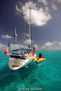 Tobago Cays, vendor and yachties! by Kay Wilson