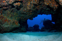 A Cayman Island swim through.  Just a hint of flash to pi... by Paul Colley