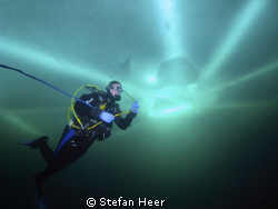 Ice Diver with the safety mark in the background. I took ... by Stefan Heer