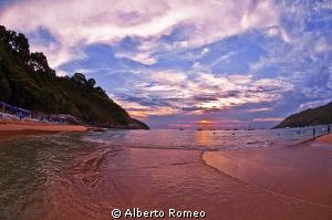 Sunset at the beach of Puket. by Alberto Romeo
