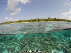 Over/Under Helengeli Maldives with my Sea&Sea DX 1G by Stefan Heer