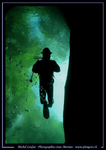 """Diving one of the """"holes"""" in the Verzasca River last year... by Michel Lonfat"""
