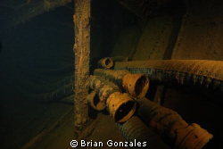 Oil Hoses in Oil Tanker, Truk Lagoon. by Brian Gonzales