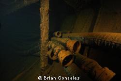 Oil Hoses in Oil Tanker, Truk Lagoon. by Brian Gonzales