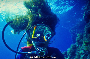 Reflection on the dive-masck. NO P.S. by Alberto Romeo