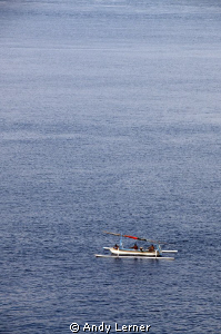 Family fishing near sundown in Amed Bali by Andy Lerner