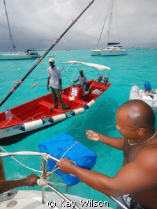 Paying park fees in the Tobago Cays. by Kay Wilson
