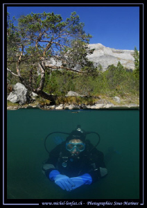 My wife Caroline diving a Lake in the Swiss Alps... Que d... by Michel Lonfat