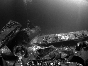 Zeros in the cargo hold of the Fujikawa Maru. Natural li... by Jackie Campbell