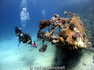 Sunken yacht at small abu galawa. Taken with canon ixus 9... by Jackie Campbell
