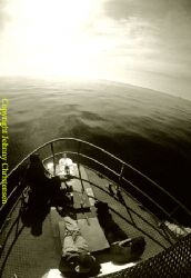 Sailing to the divesite in calm conditions is a rare trea... by Johnny Christensen