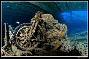 Motorcycle on the Thistlegorm. by Dray Van Beeck
