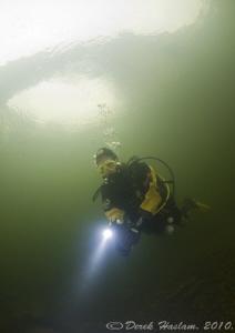 Chris under Devils bridge. River Lune. D3, 16mm. by Derek Haslam