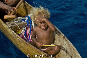 The unusual blonde hair of some of the local children fou... by Larry Polster