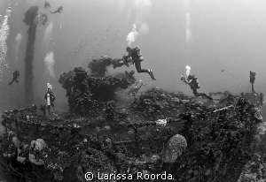 A busy afternoon at the Unkai Maru, Truk Lagoon. by Larissa Roorda