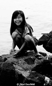 This young Indonesian girl was busy catching small fish, ... by Paul Duxfield