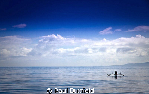 Calm and tranquility, as this lone fisherman waits patien... by Paul Duxfield