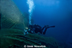 A diver making a video documentary on TETI wreck.  About ... by Gosia Nowodyla